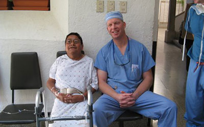 Bertrand Kaper M.D. With Patient from Operation Walk